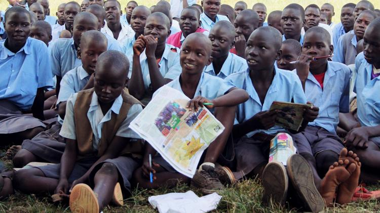 Adolescents in Nwoya District, Uganda, attend an outreach event conducted by Nwoya Youth Center on sexual and reproductive health